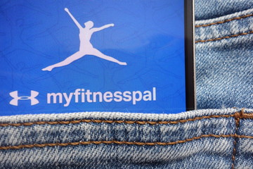 KONSKIE, POLAND - JUNE 12, 2018: Myfitnesspal logo displayed on smartphone hidden in jeans pocket