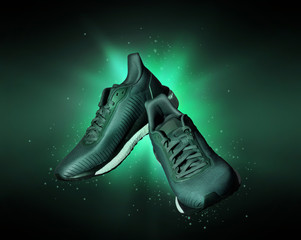 Technological running shoes with a flash of green light in the dark