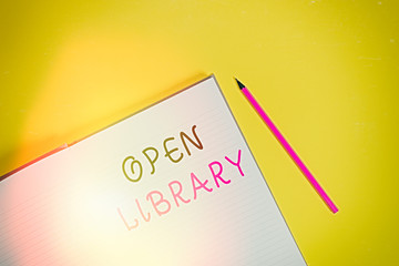 Text sign showing Open Library. Business photo text online access to many public domain and outofprint books Open striped hard cover notebook lying pencil marker color background