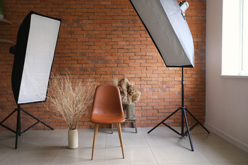 Interior of modern photo studio with brick wall