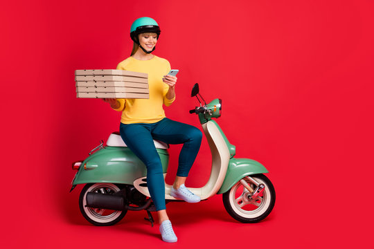 Full length body size view of her she nice attractive cheerful cheery girl sitting on moped carrying bringing italian bakery using cell isolated on bright vivid shine vibrant red color background