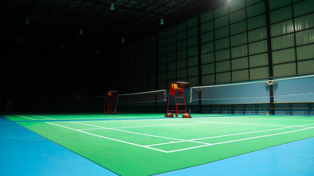 The green badminton court used in competition and exercise for being polite and good.