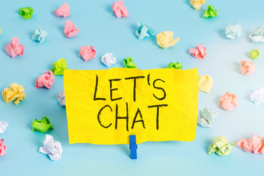 Handwriting text writing Lets Is Chat. Conceptual photo inviting the demonstrating to have informal conversation with you Colored crumpled papers empty reminder blue floor background clothespin