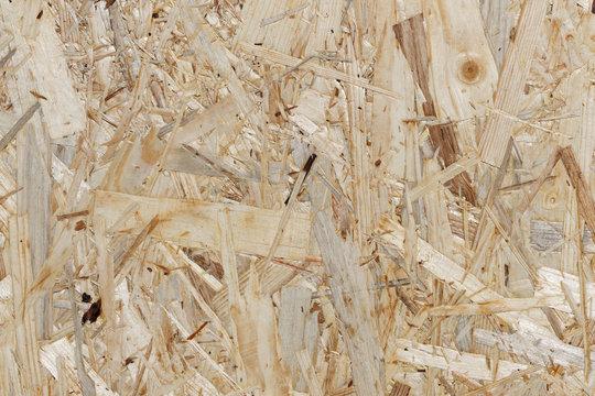 Abfallholz-Recycling: Ausschnitt einer Grobspanplatte als Hintergrund