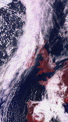 Satellite map of Europe with a warning red tones. Spain and England are covered with clouds. contains modified Copernicus Sentinel data