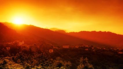 Fotorollo Braun Foggy sunset at the San Nicolao village in Corsica mountain