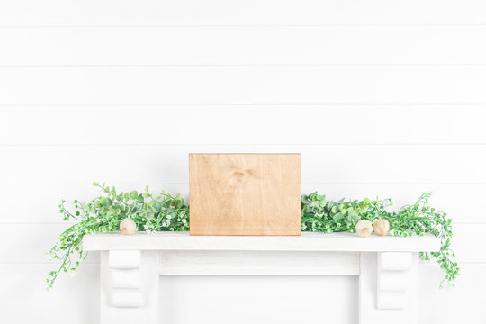 Wooden sign on mantelpiece - light wood plank for your design
