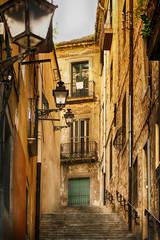 Canvas Prints Narrow alley Narrow medieval street in Barcelona, Spain