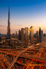 The view of Dubai skyline with Burj Khalifa and Sheikh Zayed road at dusk, UAE