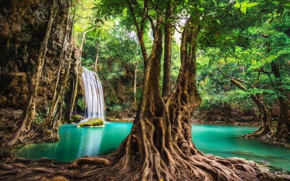 Beautiful nature scenic landscape Erawan waterfall in deep tropical jungle rain forest, Attraction famous landmark tourist travel Kanchanaburi Thailand vacation trips, Tourism destinations place Asia