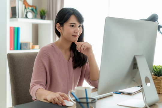 Young asian businesswoman using computer work from home for protect virus and take care of their health from COVID-19. Working at home and social distancing concept.