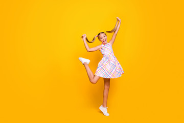 Keuken foto achterwand Wanddecoratie met eigen foto Full body photo of beautiful small lady tourist good mood hold raise pretty long tails playful girl wear plaid summer dress sneakers isolated yellow vibrant color background