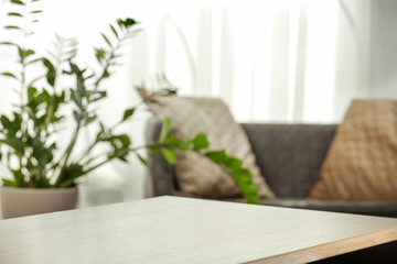 Fototapete - Spring time and wooden desk in home interior with blurred window.