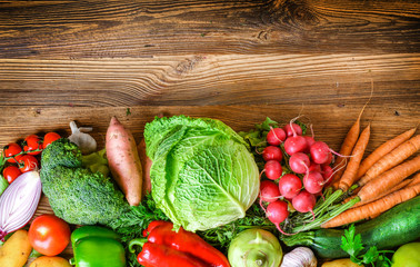 Vegetables on wood. Healthy various vegetable food, herbs and spices. Space for text.