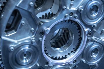 Jet engine gear wheels, industrial background. Blue toned. Fotomurales