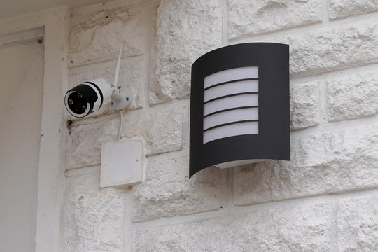 exterior lighting and security concept home street camera surveillance cctv house building