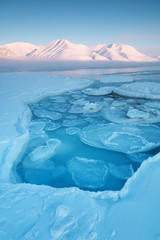 Spoed Fotobehang Blauw Norway landscape ice nature of the glacier mountains of Spitsbergen, Longyearbyen, Svalbard. Arctic ocean during winter polar day and colorful sunset sky Arctica area, Global warming Amazing nature
