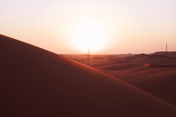 Canvas Prints Magenta Bright sunrise on the red sand dunes of the Arabian desert in Riyadh, Saudi Arabia. New beginnings, symbol of hope and brighter tomorrow.