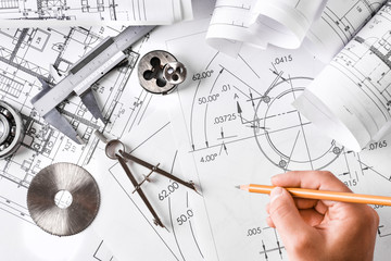 Engineer technicial drawings and mechanical parts engineering industry work project paper prints....