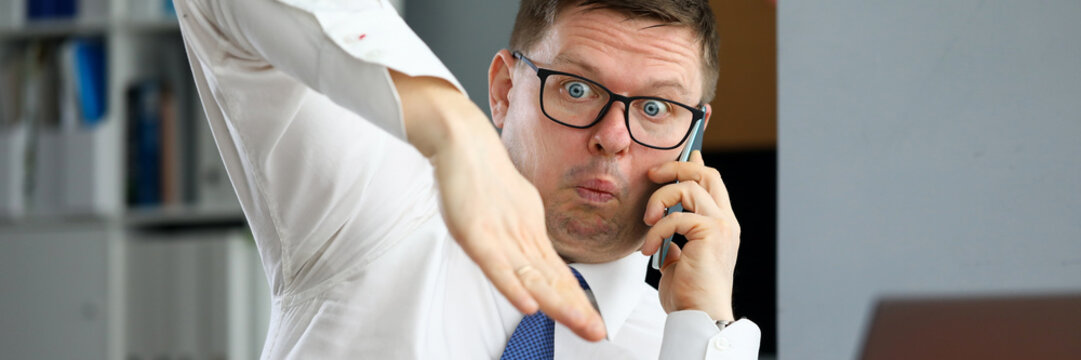 Male executive talking cellphone about bad consequences