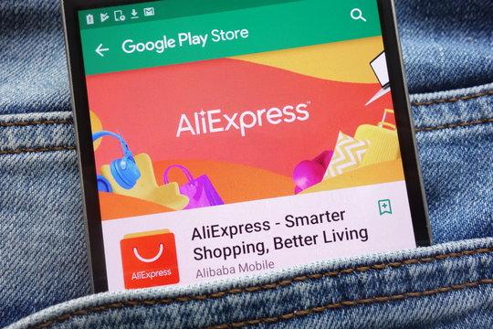 KONSKIE, POLAND - JUNE 09, 2018: AliExpress app on Google Play Store website displayed on smartphone hidden in jeans pocket