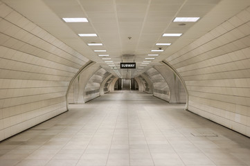 Underground subway station hallway tunnel with escalator. Abstract perspective view