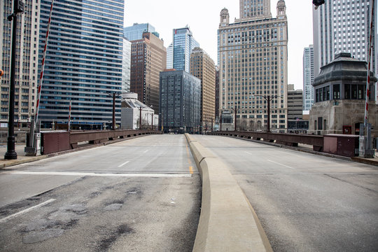 Chicago,IL/USA-March 24th 2020: Streets of downtown Chicago around State street and Michigan ave are completely isolated, desolated, empty  due the national health pandemic Covid-19. Business suffer