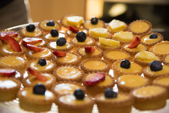 Close up of fruit tarts with blueberry, strawberry and pineapple