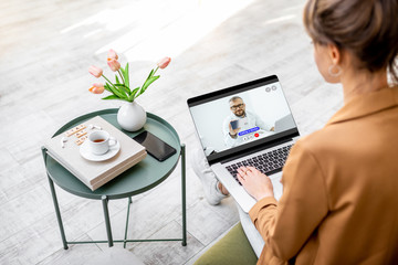 Business woman having online consultation with a doctor while sitting at home. Work from home and medicine concept during a quarantine