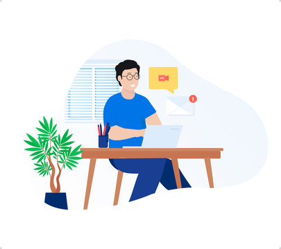 The young man freelancer doing work from home with laptop and email message notification