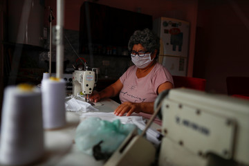 Hilda Acosta, a volunteer at a soup kichen, sews face masks for the low-income people at her home, during the spread of the coronavirus disease (COVID-19), in Florencio Varela, in the outskirts of Buenos Aires
