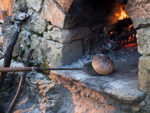 Baking bread in a oven built using stones.