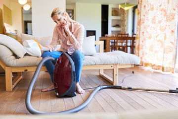 Cleaning lady with vacuum cleaner and vacuum cleaner bag