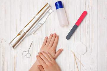 Wall Mural - Woman removes nail polish at home.