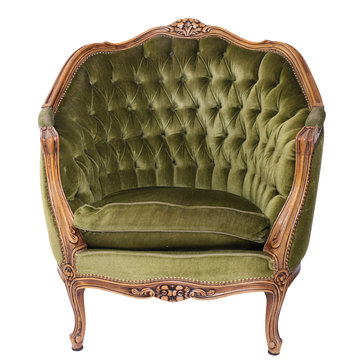 Luxurious, antique green armchair on a white, isolated background. Old, palace furniture.
