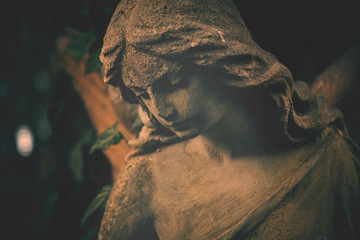 Fototapete - Sad eyes of angel. Ancient stone statue. Death, pain and end of life concept.