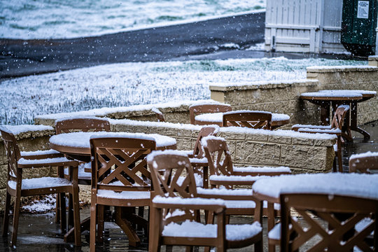 table and chairs in the snow