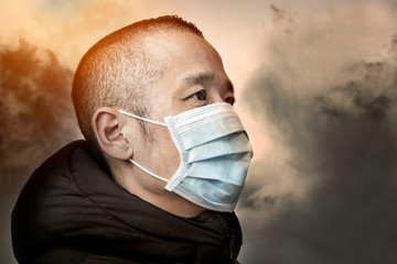 Middle aged Asian man wearing medical face mask