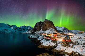 Tuinposter Aubergine Aurora borealis over Hamnoy in Norway