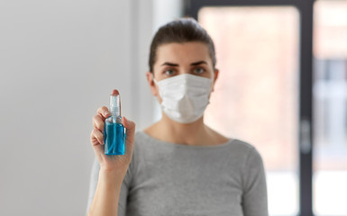 hygiene, health care and safety concept - close up of woman wearing protective medical mask holding...