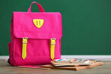 School backpack on table in classroom