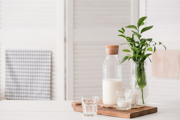 Glassware of fresh milk on table