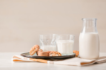 Glassware of fresh milk and cookies on table