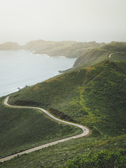 Printed kitchen splashbacks Khaki Cyclist Riding Through the Winding Road of the Marin Headland