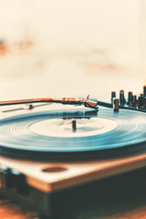 Close-up vinyl record player with back blurred background