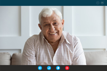 Head shot screen software application view happy middle aged elderly man communicating chatting...