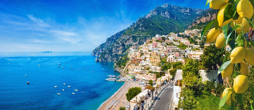 Panoramic view of Positano with comfortable beaches and blue sea on Amalfi Coast in Campania, Italy. Amalfi coast is popular travel and holyday destination in Europe.