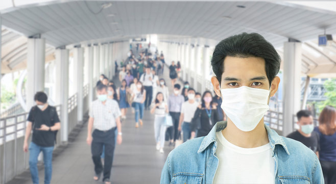 Double Exposure image of Asian worker or business man wearing surgical mask hands covered her mouth while coughing with blurred of crowed,Wuhan coronavirus (COVID-19) outbreak pandemic prevention.
