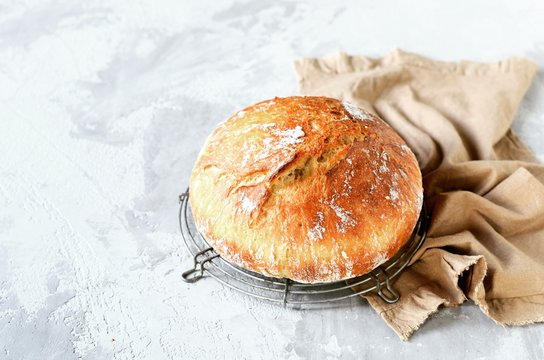 Tasty homemade bread on a gray background