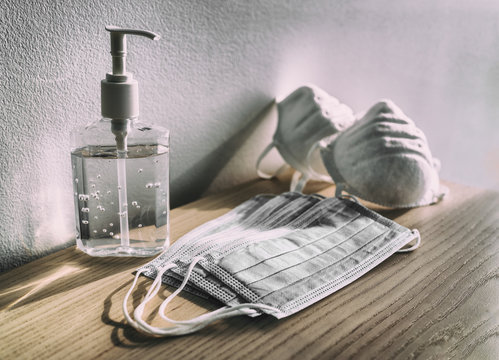 COVID-19 coronavirus prevention medical ear loop masks, n95 respirators, hand sanitizer gel bottle for hand hygiene corona virus protection.